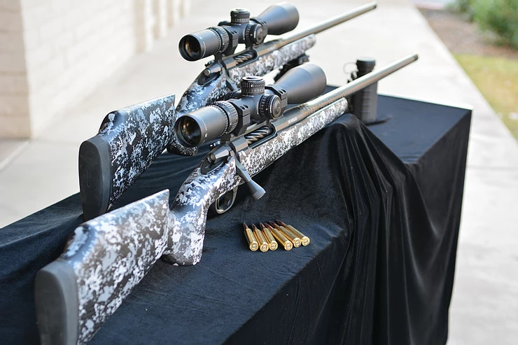 rifles set up on table