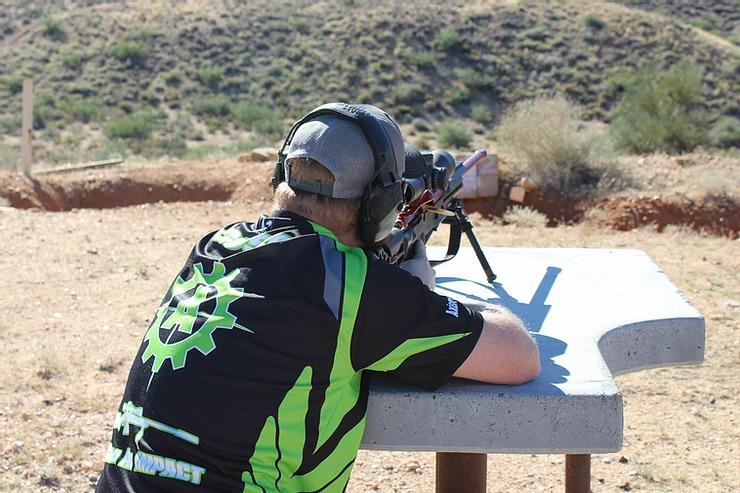 Man with long range shooting set up